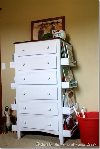 white dresser with extra storage for books on the sides