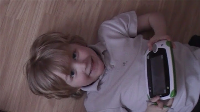 boy playing leappad explorer game