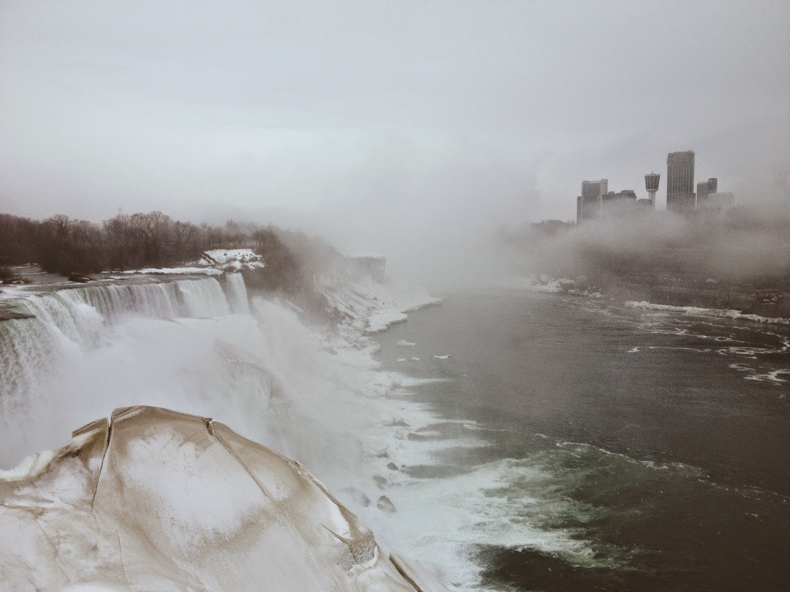 misty niagra falls with view of Canada