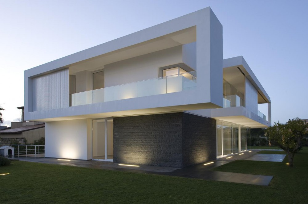 Contemporary minimalist villa design with indoor patio for Contemporary villa plans
