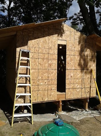 Sheathing the rest of the entry wall and the other side of the roof.