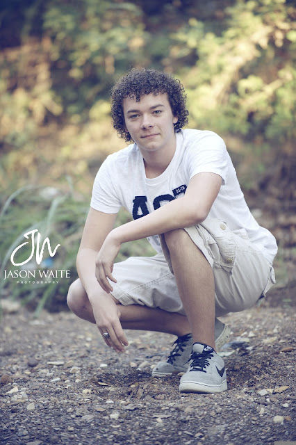 senior boy in riverbed at river legacy park
