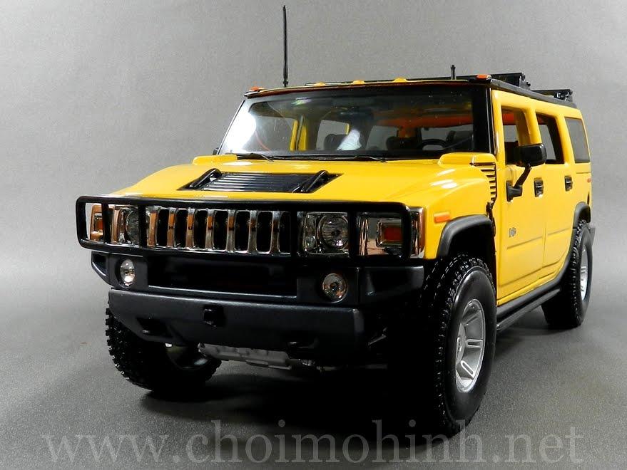 Hummer H2 SUV 1:18 Maisto yellow