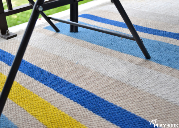 The striped DIY rug holds up great outdoors!