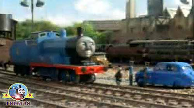Thomas the tank engine Edward the really useful engine cargo trucks and Sodor the Fat Controller