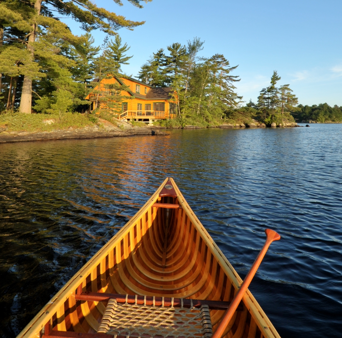 Paddling A Canoe Backto A Lakeside Retreat Is One Of The Joys Of . Full resolution  portrait, nominally Width 1109 Height 1096 pixels, portrait with #1B71B0.