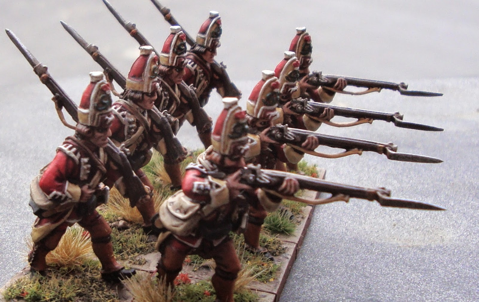 "Fig. 7 Conquest makes two poses, the ""road marchers"" and the ""firers."" They can rank up together, but it would look better if the rear rank was standing still, or loading or something."