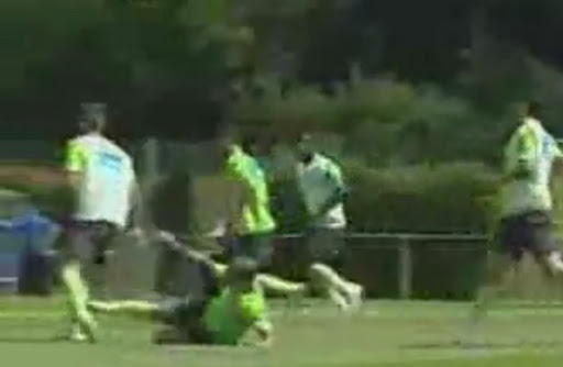 Portugal player Ricardo Quaresma kicks teammate Miguel Lopes for tackling him in training