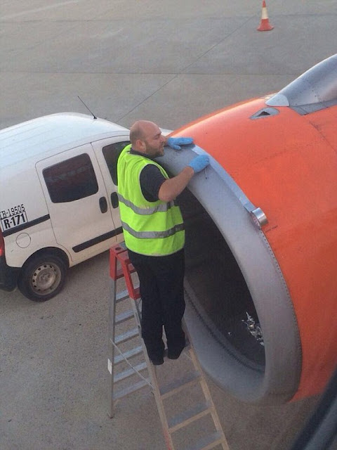 Shocked passenger takes photo of airport worker using TAPE on engine shell of easyJet plane moments before take-off
