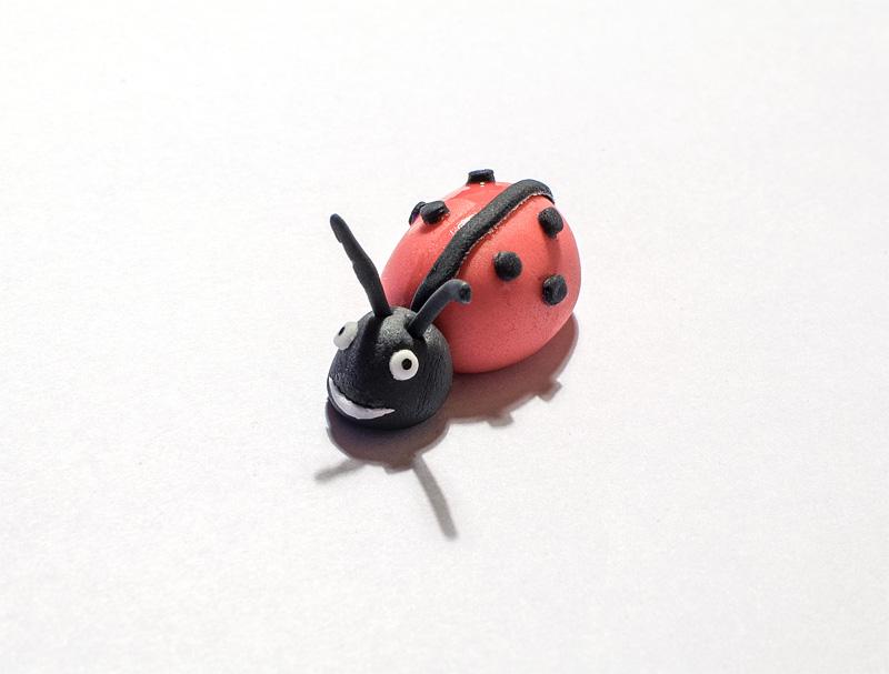 Ladybug fondant figure antennaes on head