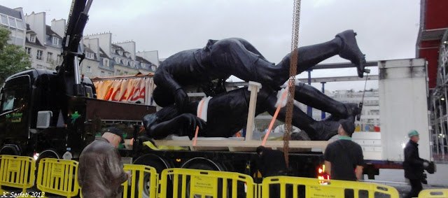 Zinedine Zidane headbutt statue on a truck before installation