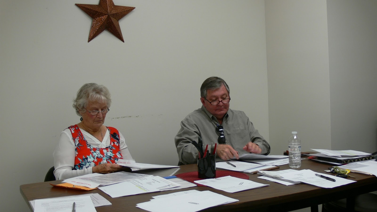 Board of Elections Secretary Sara Waldoop (L) and  board member Gary Dills (R) verify provisional ballots