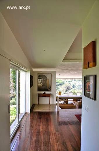 Interior de la casa sector social con comedor y sala de estar