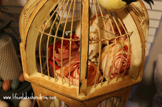 spring decor with bird cage, butterfly tea pitcher, roses