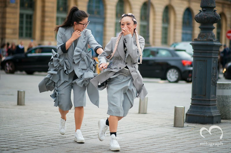 Women wearing Comme des Garcons Suits at Paris Fashion Week.