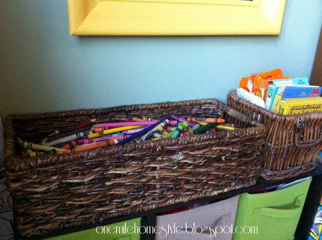 Crayons stored in a wicker basket