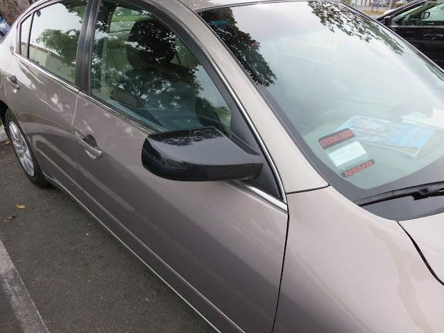 2012 Nissan Altima with recycled door and new mirror at Almost Everything Auto Body