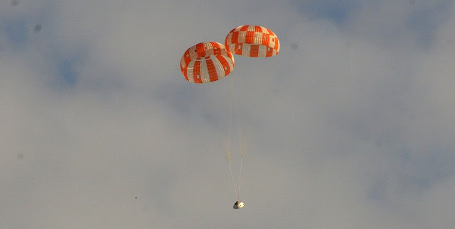 A test version of NASA's Orion spacecraft successfully landed under two main parachutes in the Arizona desert Aug. 26. At the U.S. Army's Yuma Proving Ground, engineers tested a failure scenario in which one of the spacecraft's two drogue parachutes and one of its three main parachutes did not deploy. The test is helping to ensure the parachute system can safely land future astronauts returning from deep space missions even if something with the parachute does not go as planned. Credit: NASA