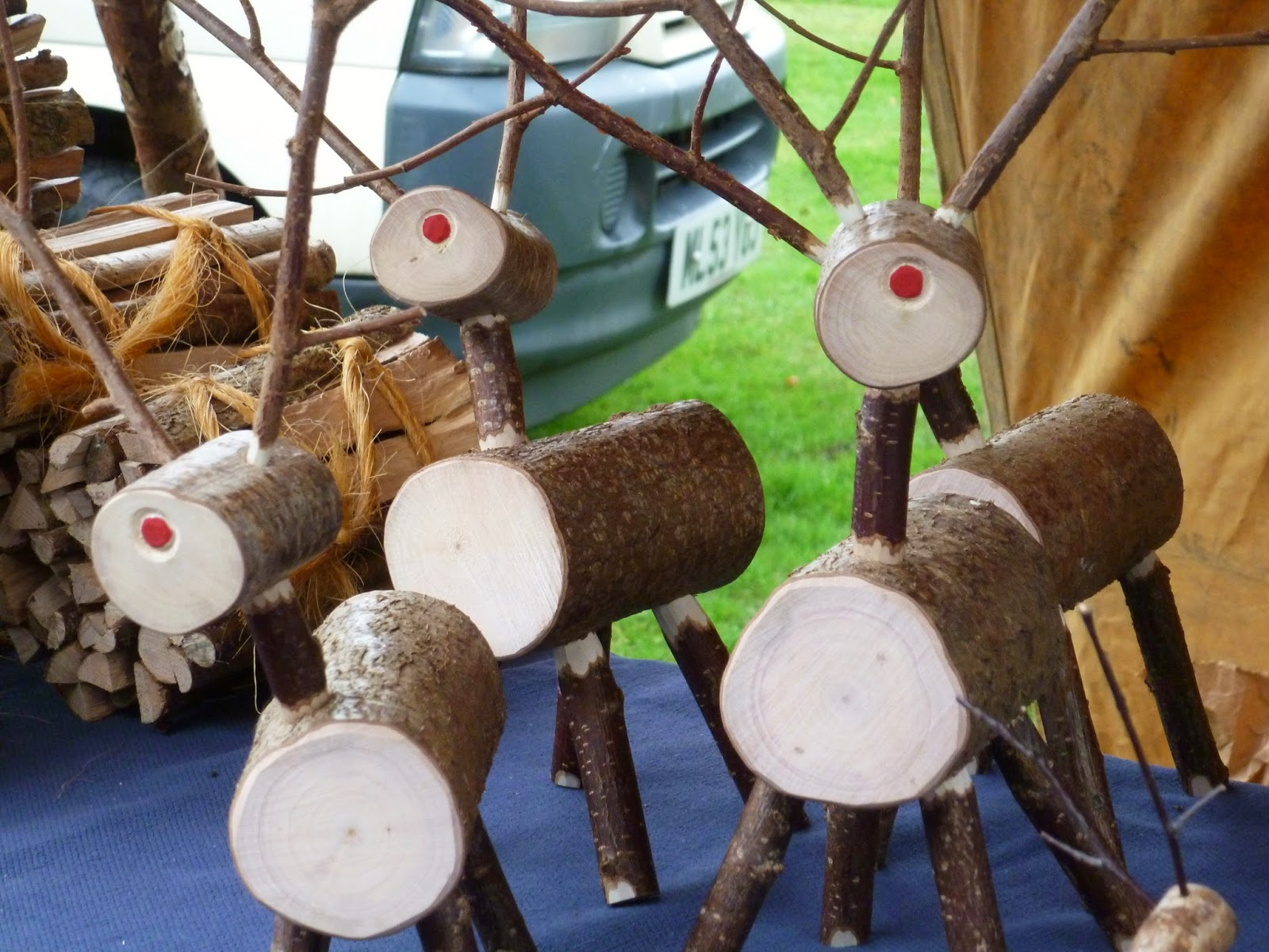Farmers market stall reindeers made out of tree stumps