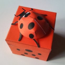 "PACKING FOR GIFT ""LADYBUG"" WITH THEIR HANDS"
