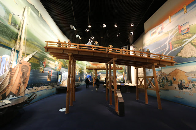 A jetty bridge connects from the land to the ships and boats at Museum of History in Osaka, Japan