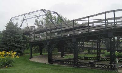 Spiral bridge ramp reaching to main span