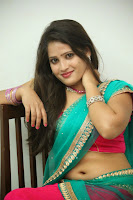 Anusha sizzling Pictures in half saree 070.JPG