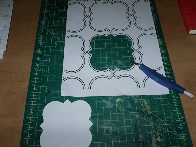 Stencil being cut out with xacto