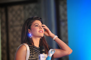 Actress Jacqueline Fernandez  Pictures in Short Dress at The Launch Of Scholl Velvet Smooth Express Pedi Electronic Foot File In Four Seasons  63.JPG
