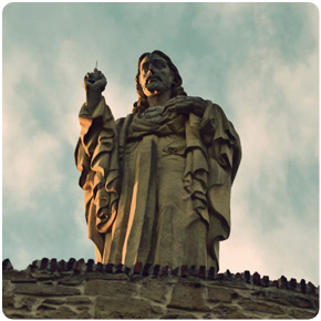 giant statue of Jesus on a hill overlooking La Concha Bay.