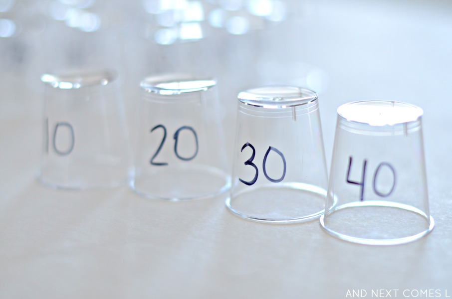 Practicing skip counting with DIY math cups from And Next Comes L