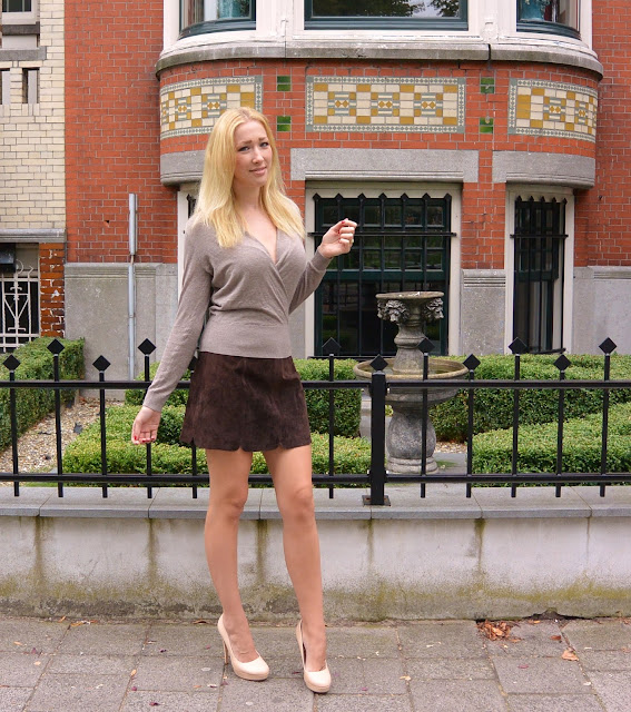 http://www.dashinglyelevating.com/2015/09/brown-leather-scalloped-skirt-beige.html