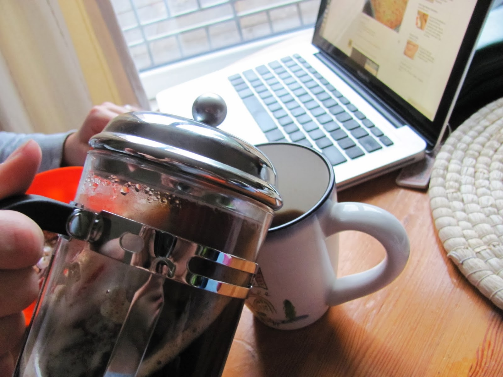 Pouring coffee from the cafetiere French press in Dublin, Ireland