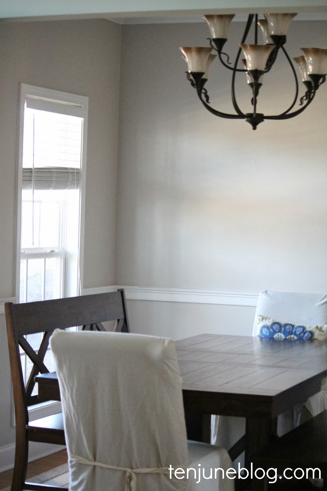 ten june dining room paint makeover sherwin williams agreeable gray the best part is that slowly but surely i m starting to love this room with the paint makeover and the addition of our new benches it s starting to feel