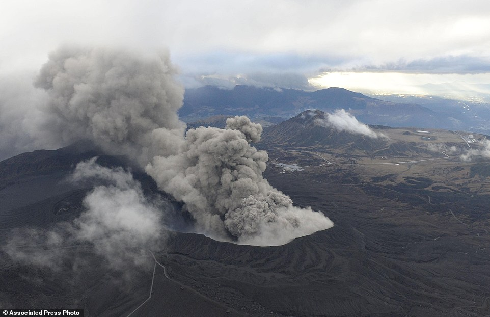 After two deadly earthquakes and dozens of powerful aftershocks Japan's Mount Aso volcano erupts...