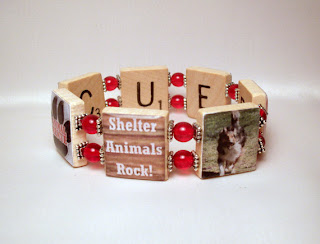 Upcycled pet rescue bracelet made with dog and cat images along with rescue words adhered to vintage Scrabble tiles.