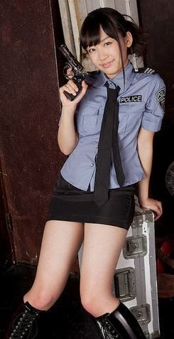 Asian cop girl with a gun