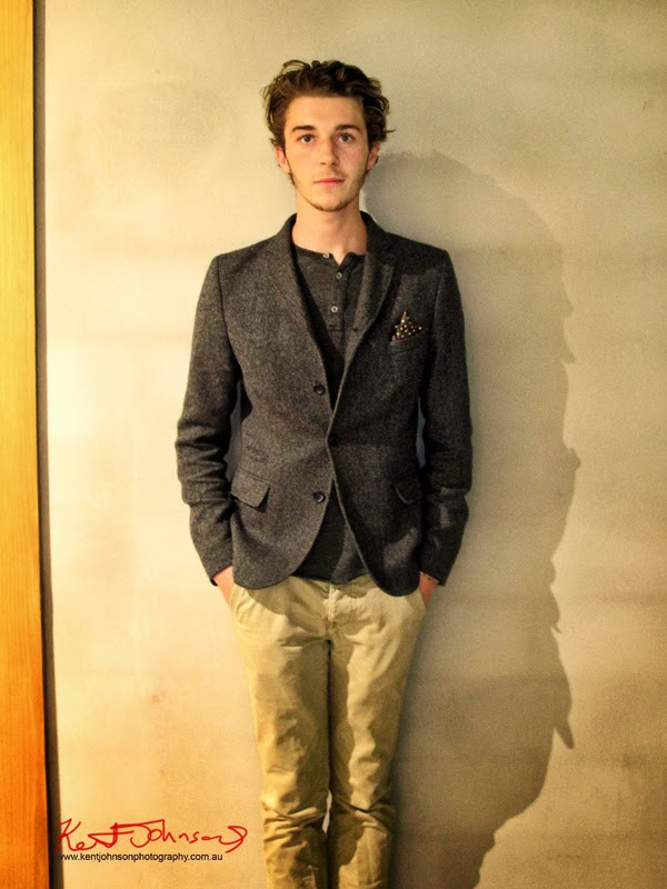 Max wearing grey collarless three button shirt and grey tweed jacket and Chinos. Photographed by Kent Johnson.