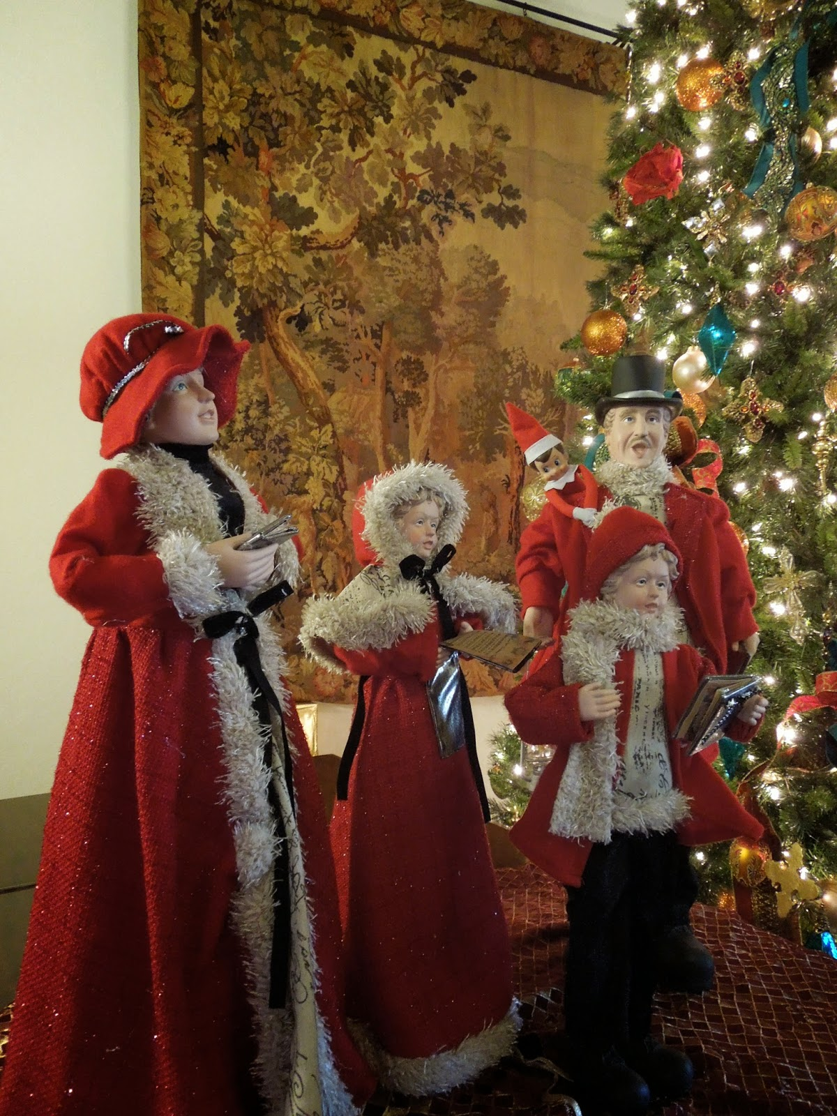 carolers and elf