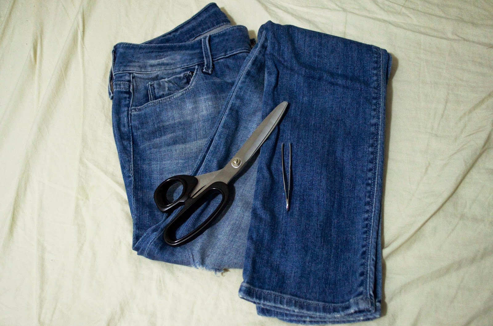 scissors diy do it yourself jeans ripped knee distressed thrifted op shopped second hand tweezers permanent marker sharpie