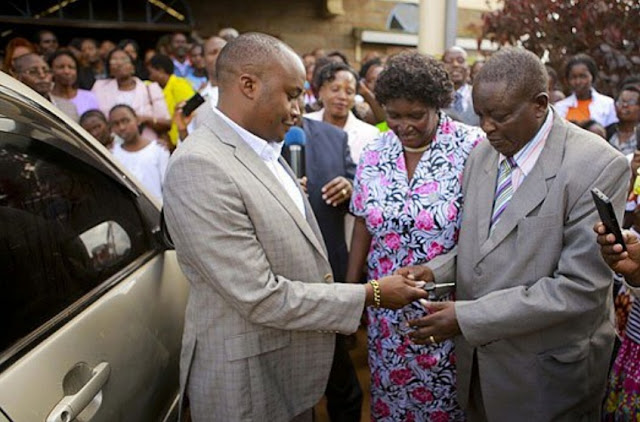 jaguar presents a car to his primary school teacher