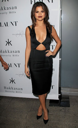 Selena Gomez showing lots of cleavage in the red carpet at Flaunt magazine issue party