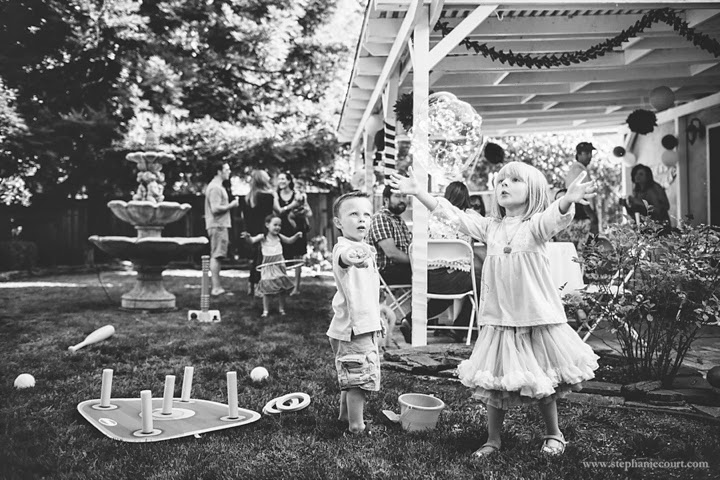 children playing with bubbles at birthday party