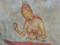 Beautiful topless ancient Lankan lady with flower, fresco in Sigiriya, Sri Lanka graffiti, point of interest