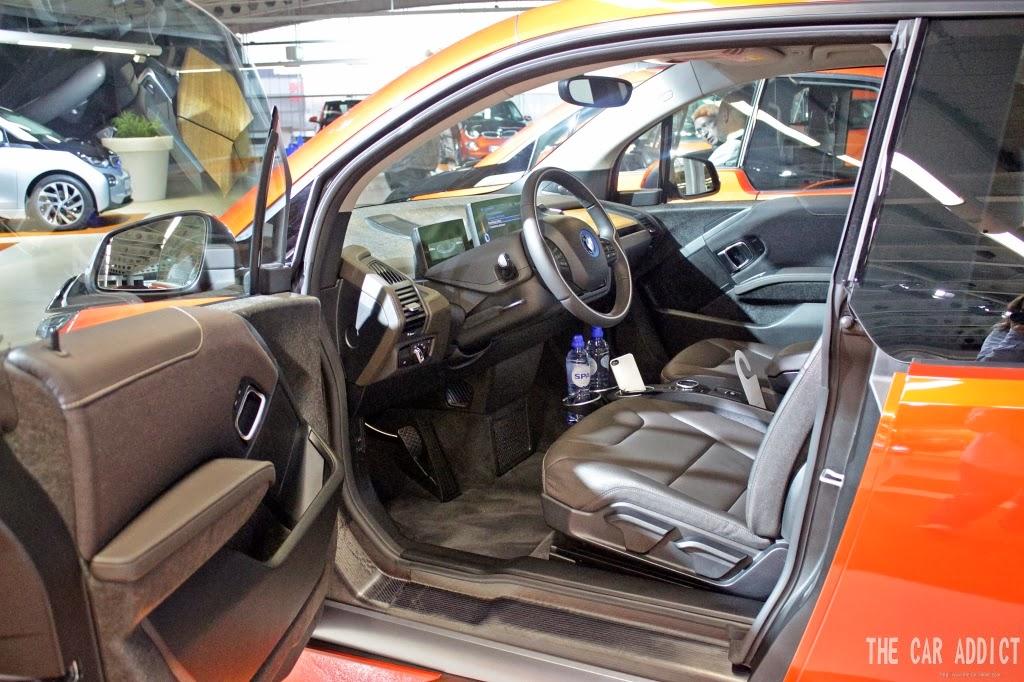 orange BMW i3 brown leather interior