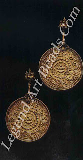 KOPPU (ear studs) Kerala 19th century Sheet gold stamped in relief with an image of goddess Lakshmi in the centre.