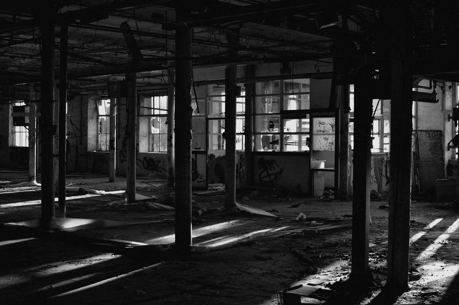 uncanny, texture, stillness, tone, memory, time, fragility, urbex, photography, black and white, tone, atmosphere, fothergill and harvey, rock nook mill, shadows, narrative, eerie, factory, abandoned, derelict, light, natural light, society, greater Manchester, Littleborough, industrial revolution, ruins, apocalypse, separation, place, explore, adventure,