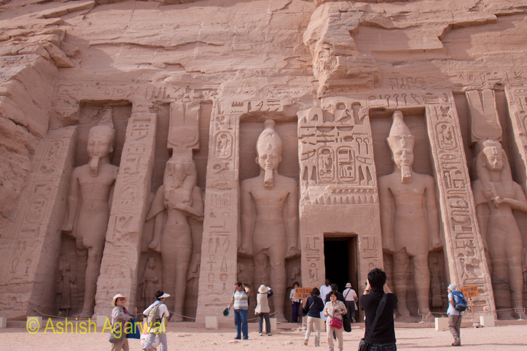 Tourists at the entrance to the smaller temple, dedicated to the queen, at the temple of Abu Simbel