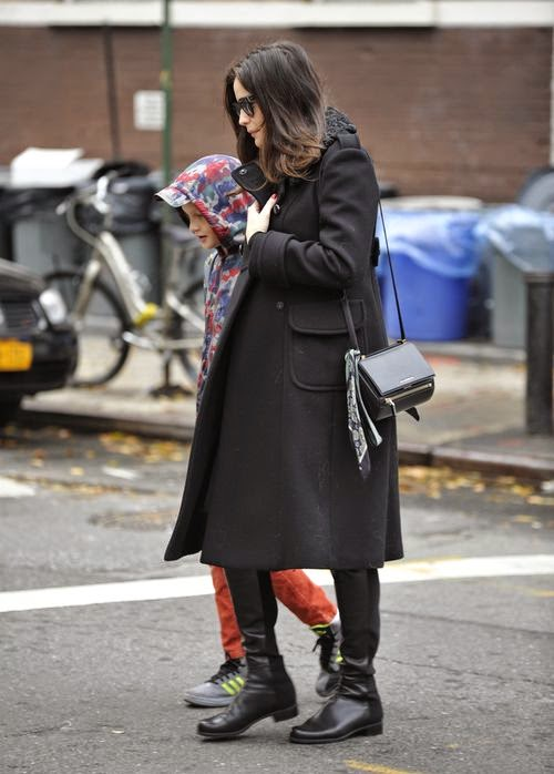 With great coat by NYC: Liv Tyler hides her baby bump