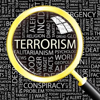A collage of words describing terrorism.